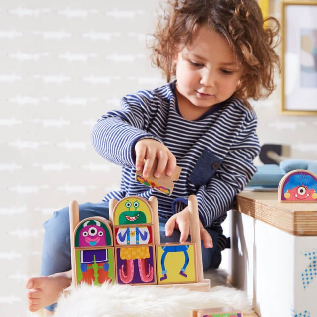 Child Playing with Monster Blocks