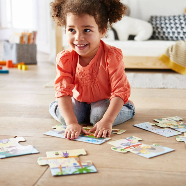 Child Playing with That's Silly Zoo Animals Puzzle